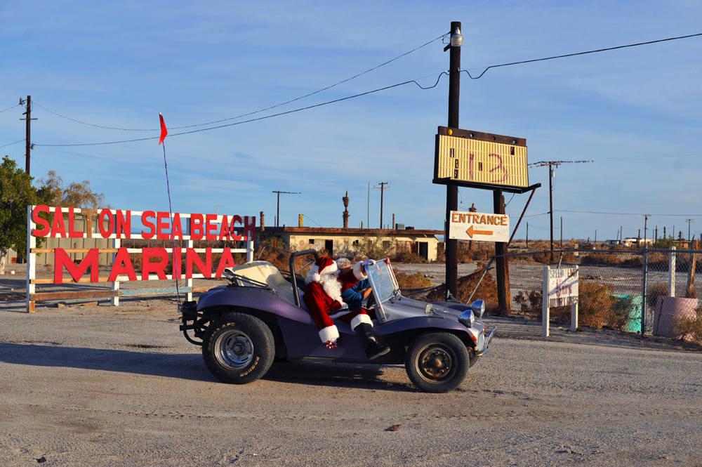 A classic dune buggy with Santa Claus impersonator makes an exit out of nearly abandoned Salton Sea Beach Marina.The Salton Sea's increasing salinity, algae, and bacteria levels have taken their toll on tourism and local communities as many of the Salton Sea's surrounding resorts are closed and communities are abandoned.