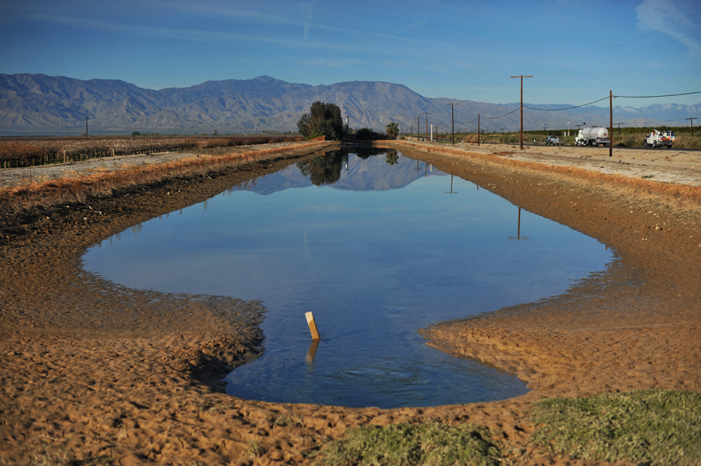 The Orocopia Mountains are reflected on the small farm reservoir, north of the Salton Sea. Agribusiness is a  billiondollar economy in the Salton Sea area and the Imperial Valley, south of the Salton Sea.