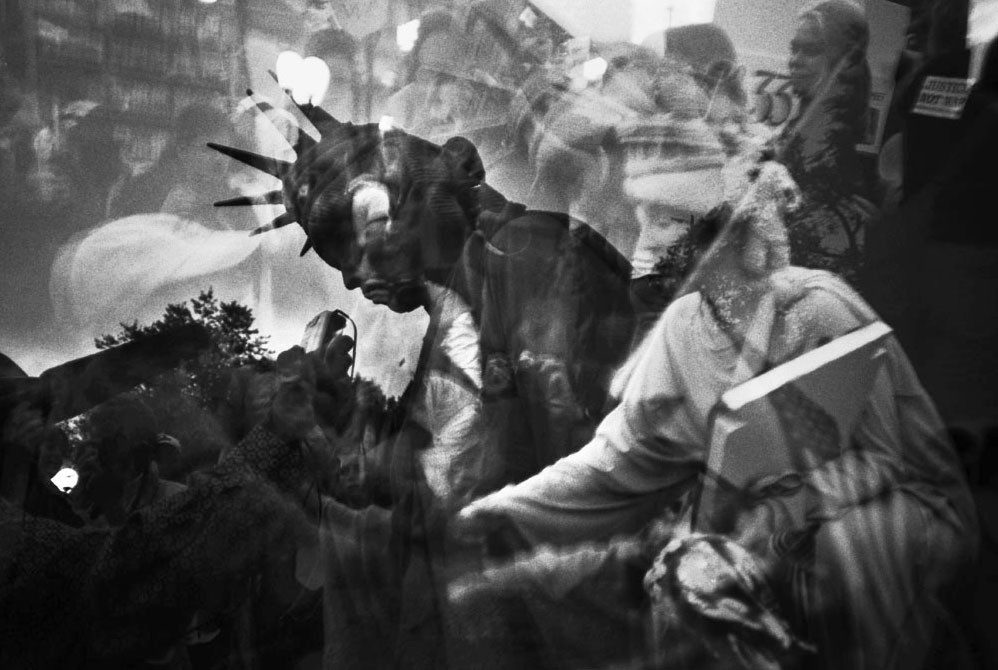 Accidental multiple exposure at the end of 35mm roll film. 9.11 commemoration and anti-war rally in Union Square Park, Manhattan, NY. September 20, 2001.