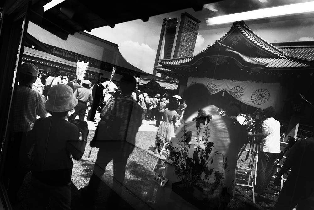 Yasukuni Shrine's Main Hall (Haiden) is reflected on the showcase of Ikebana, Japanese Art of flower arrangement, on August 15th, 2008.