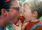 Kyle Naugle 2, and his father Jeffery Naugle,of Fayetteville,NY, share a tender moment by taking a bit of a crisp,red apple at the 27th annual LaFayette Apple Festival, NY.