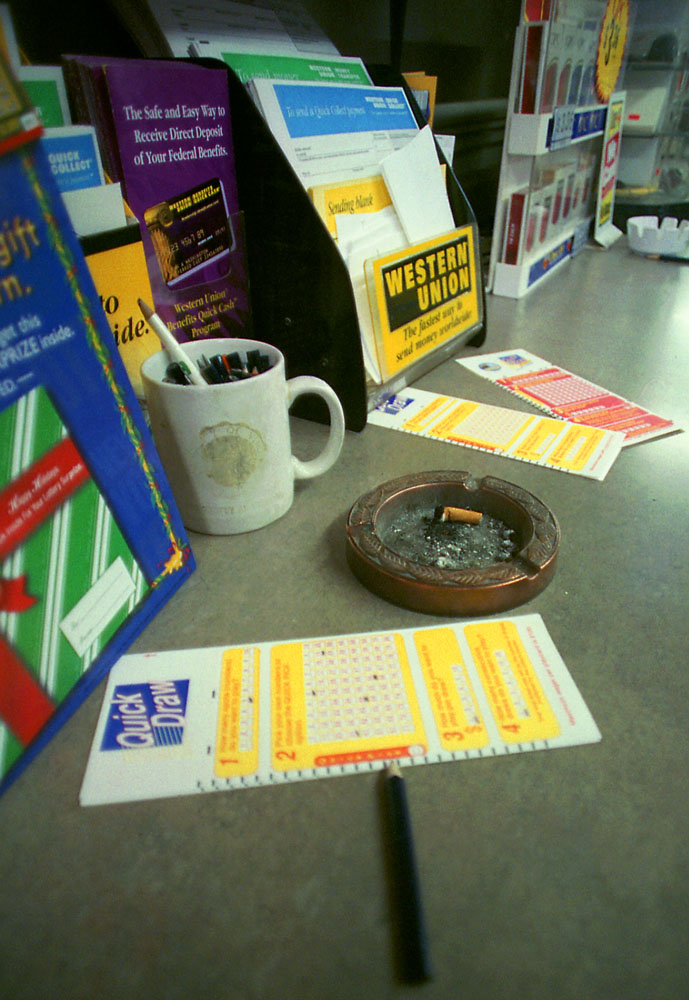 Quick Draw playcards and a cigarette bud on the counter.
