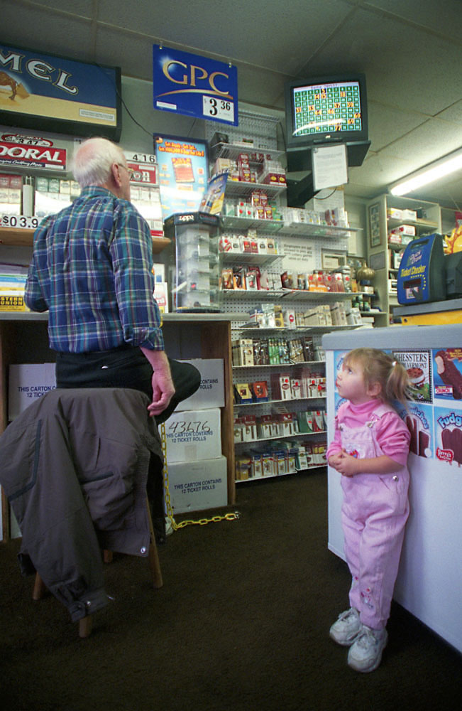 Jennifer Fantacone,2,stares at one of betting customers.