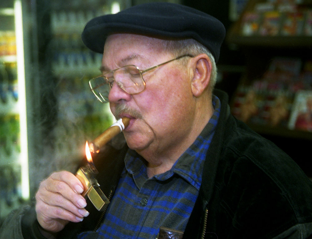 Wally Cramer,a regular visitor,enjoys a puff of smoke.