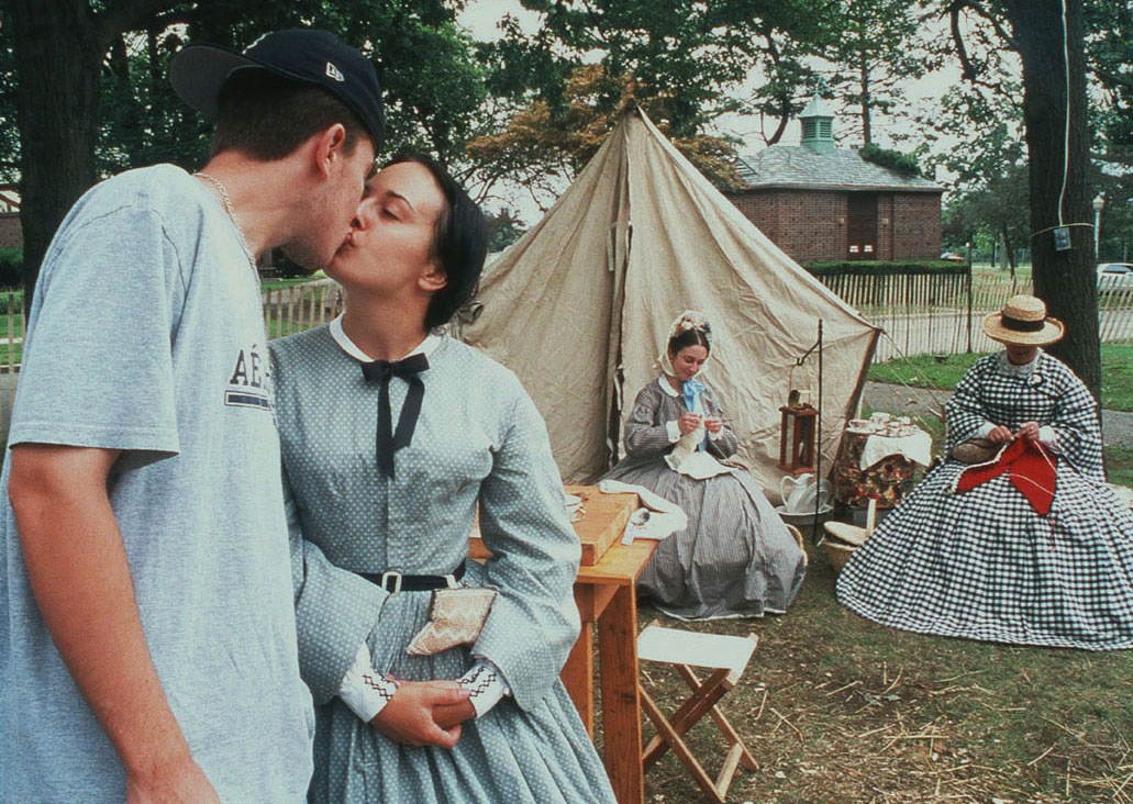 James Harris, 20, of Valley Stream, pauses for a kiss with his girlfriend, Alaina Zulli,18,of Riverhead, who is participating in {quote}Civil War{quote} life at Eisenhower Park's International Heritage Festival,Long Island,NY.Zulli plans to study historical costumes at New York University. {quote}This is my passion, I enjoy wearing these clothes,{quote} she said.  (c) Newsday