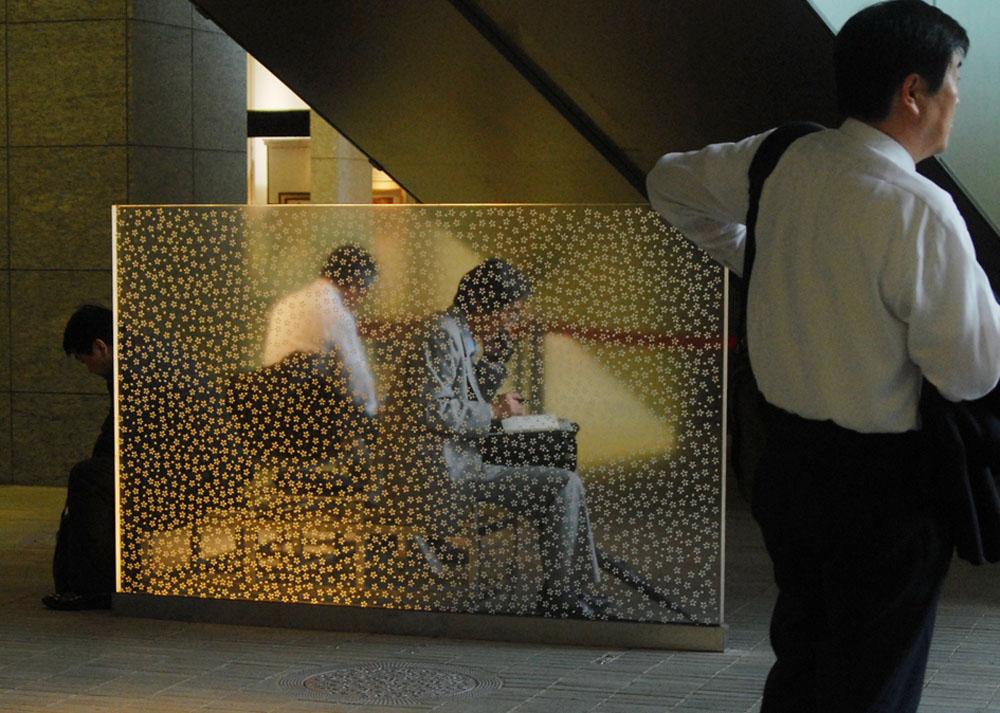 Japanese business men taking an afternoonbreak at Marunouchi Oazo center, Tokyo.