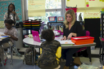 Sixth grade teacher Erin Henry reviews homework with one of her students at Beulah Shoesmith Elementary School, October 7, 2016.