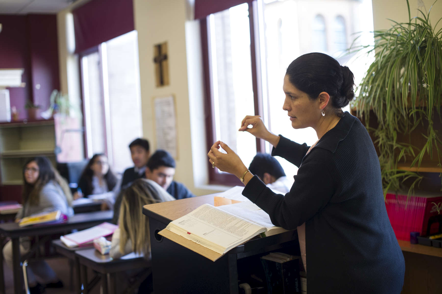 Part-time teacher Rosa Walke comments on a presentation made by a group of students during an AP Spanish Class at Cristo Rey Jesuit High School, October 19, 2016.