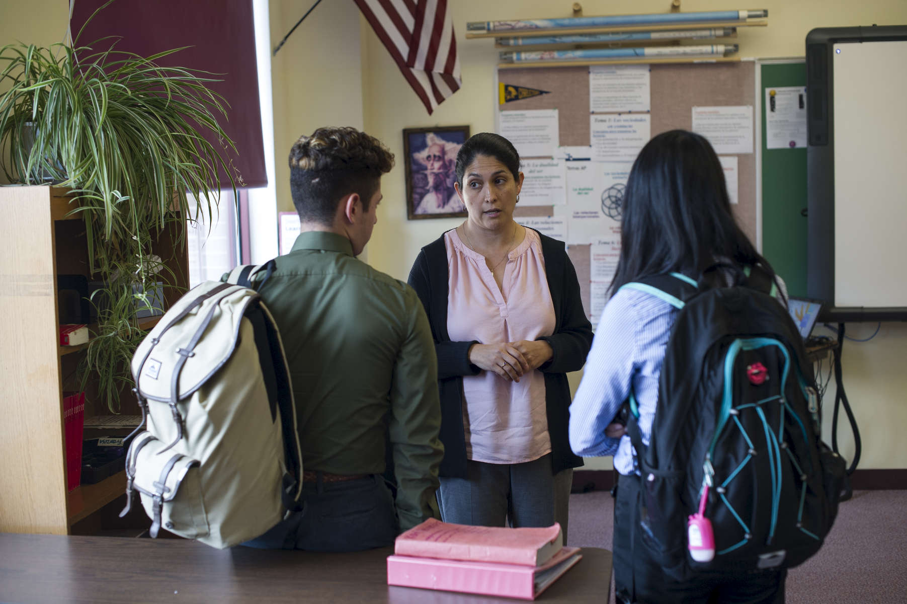 Part-time teacher Rosa Walke speaks to two student about laughing during a student presentation in an AP Spanish Class at Cristo Rey Jesuit High School, October 19, 2016.