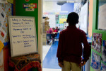 A student prepares to enter his classroom at the University of Chicago North Kenwood/Oakland Charter School.
