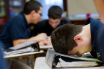 A student shows his frustration as he prepares for a class presentation at Rickover Naval Academy.