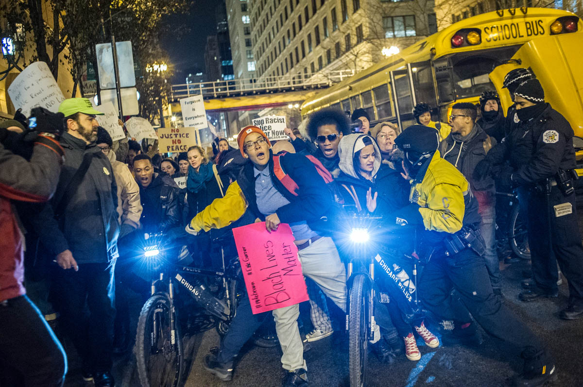 Protestors march through Chicago's Loop in protest to the shooting of Michael Brown in Ferguson, Missouri.