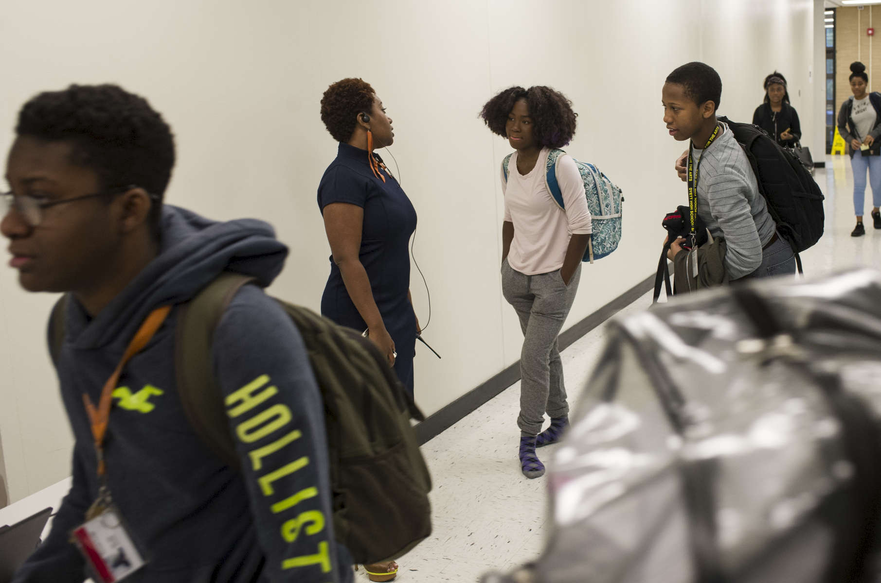 Principal Beulah McLoyd greets students in the hallway during a passing period at Dyett High School for the Arts, October 26, 2016.