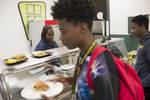 School cook Chandra Kilgore serves lunch at Dyett High School for the Arts, October 26, 2016.