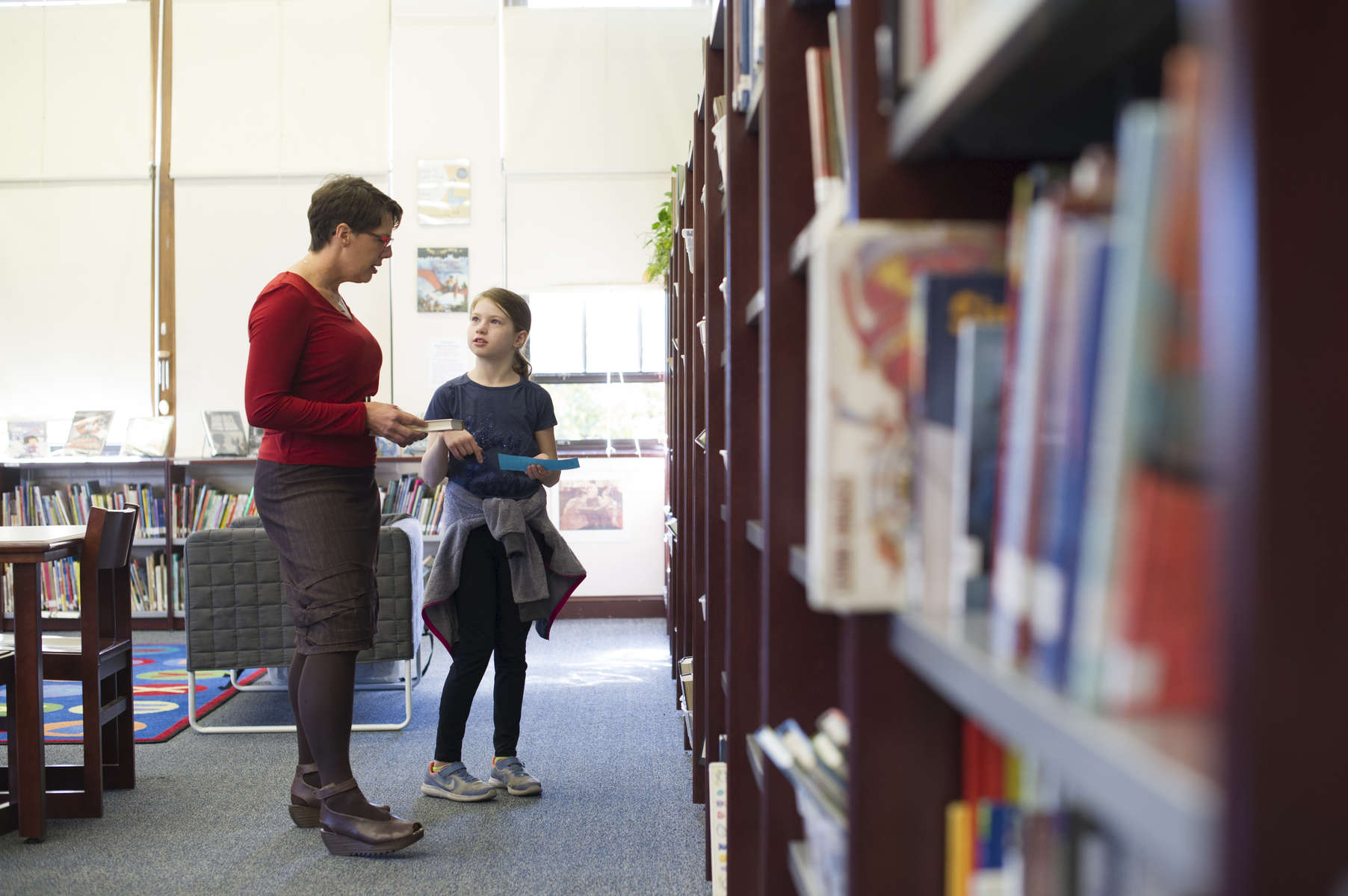 Librarian Lies Garner helps connect a fourth grade student with a good book during an unstructured library time at Hawthorne Scholastic Academy in Chicago's Lakeview neighborhood, November 10 2016.