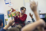 Librarian Lies Garner asks a group of first grade students if they recognize any characters or scenes from nursery rhymes in the book she is reading during their homeroom's library class at Hawthorne Scholastic Academy in Chicago's Lakeview neighborhood, November 10 2016.