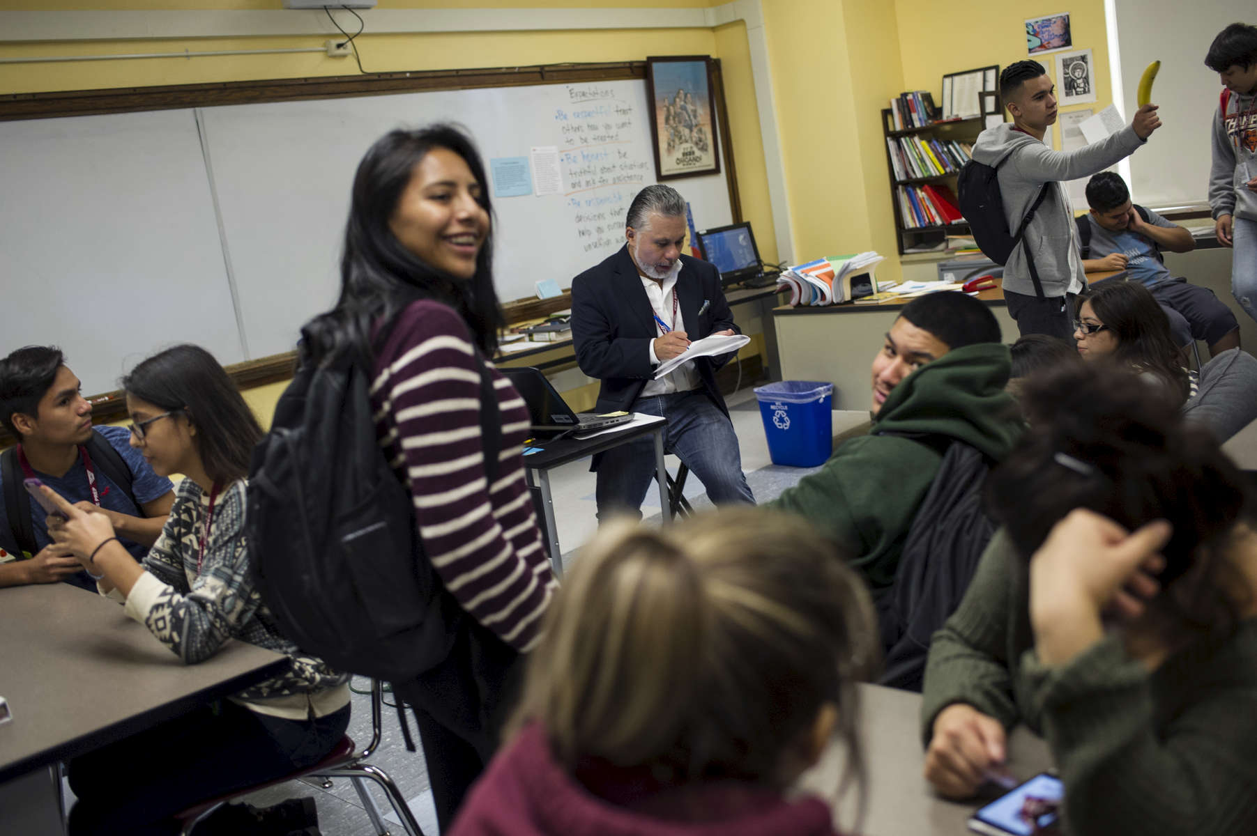 English teacher Ray Salazar takes attendance during division (homeroom) at the end of the school day at John Hancock College Prep High School October 3, 2016.