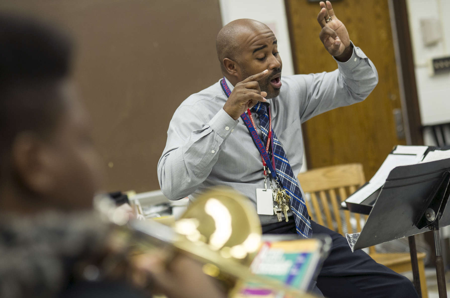 Music Department Chair and Band Director Gerald Powell conducts during a sectional meeting of the Intermediate Band class at Kenwood Academy High School, November 2, 2016.