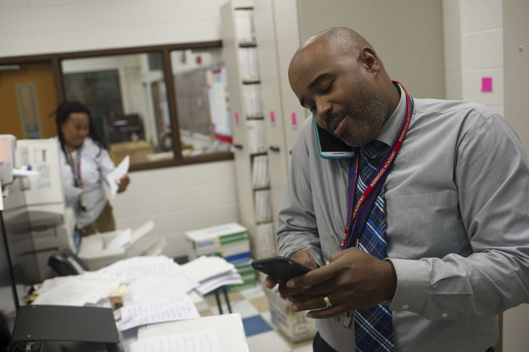At the end of the day Music Department Chair and Band Director Gerald Powell responds to phone messages in the Music Departments offices at Kenwood Academy High school, November 2, 2016.