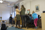 Co-teachers Carmenita Peoples and Cassandra Martin check in with each other as their students work on various tasks in the 6-year to 9 year mixed age classroom of the Montessori Academy of Chicago, October 20, 2016.