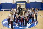 First grade students gather around physical education teacher Katie Krupa as she prepares to teach them flag-football in the gymnasium at St. Mary of the Woods Catholic School in the Edgewater neighborhood of Chicago, November 11, 2016.