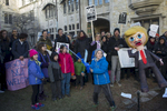 Eight-year-old Luka Vegna-Spofford prepares to decapitate a piñata effigy of Donald Trump on the courtyard lawn of University Church, 5655 S. University Ave., during a demonstration against political operative and former Trump campaign manager Corey Lewandowski as he visits the University of Chicago, Wednesday, February 15, 2017.