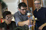 High school Science teacher Dr. Zachary Hund adjusts the height of a crucible holder for a student as he performs a decomposition of sodium bicarbonate stoichiometry laboratory experiment during a Chemistry class at the University of Chicago Laboratory Schools, November 9, 2016.