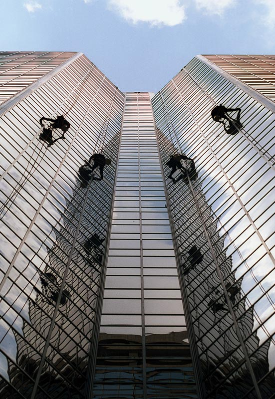 A crew of window washers descend on PNC Bank Center at 1600 Market Street in Philadelphia, July 2001. The men are working approximately 300 feet above ground on the east wall of {quote}Darth Vader{quote} a nickname the workers gave the 40-story building.