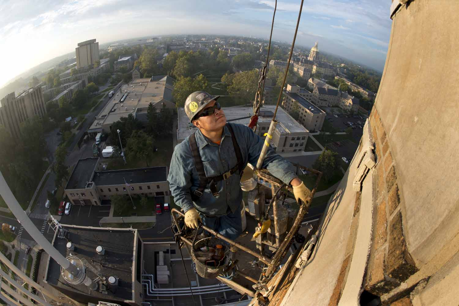 Wesley Shirley does routine maintenance on the chimney of Notre Dame's power plant.