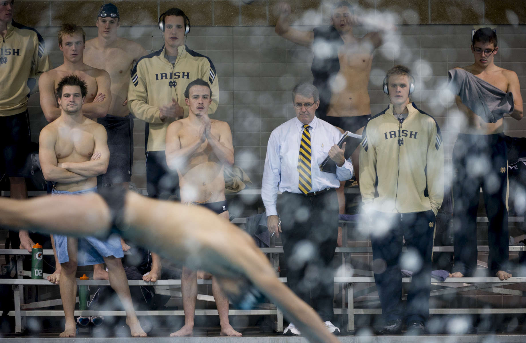 October 14, 2011; Tim Welsh head men's swimming coach cheers with team members during the Dennis Stark Relays in the Rolfs Aquatic Center. Photo by Barbara Johnston/University of Notre Dame
