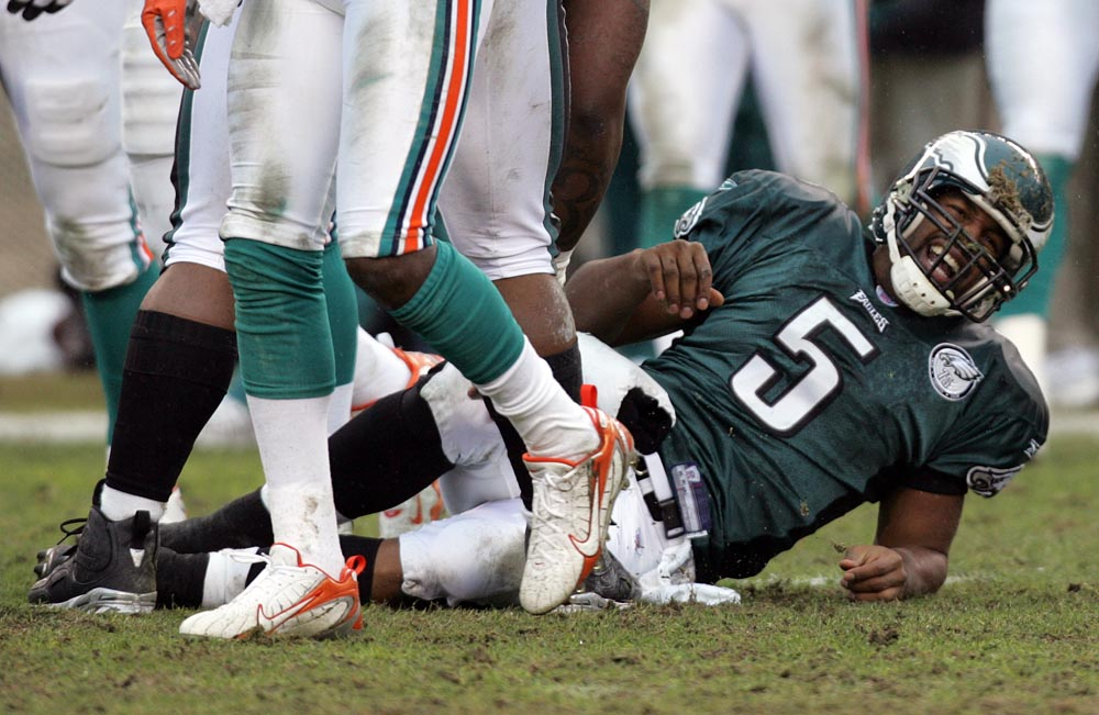 Philadelphia Eagles quarterback Donovan McNabb sustains a right ankle injury in the second quarter against the Miami Dolphins.