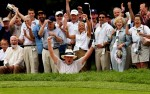 Tom Kite rejoices along with fans after making an eagle on the ninth hole from a bunker during the second round of the Senior PGA Championship at Aronimink.