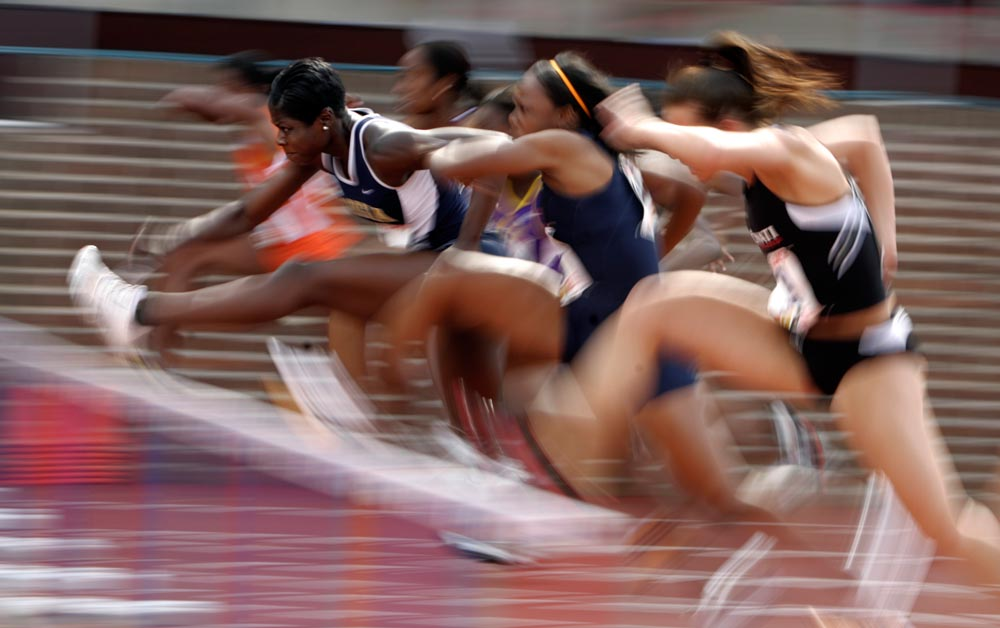 Georgia Tech's Shantia Moss takes the lead in a 100 meter hurdles heat of the 114th Penn Relays at Franklin Field