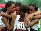 Lower Merion's (names left to right) Avis Hayes, Lorraine Weldon, Dominique Adger (back to camera) and Allison Gibbs celebrate after finishing first in the final girls AAA 4x100 relay competition.