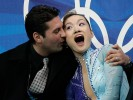 Gold medalist Shizuka Arakawa, of Japan, along with her coach Nikolai Morozov reacts as she sees her scores during the Ladies' free skating program at the 2006 Winter Olympics in Turin, Italy.