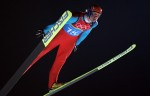 Roar Ljoekelsoey of Norway competes in the first round of the Men's Ski Jumping at the 2006 Winter Olympics in Turin, Italy.