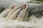 Lauren Smosynski (left) 13, and her friend Heather Aiken, 13, cool off in the Brandywine Creek on July 14, 2004.