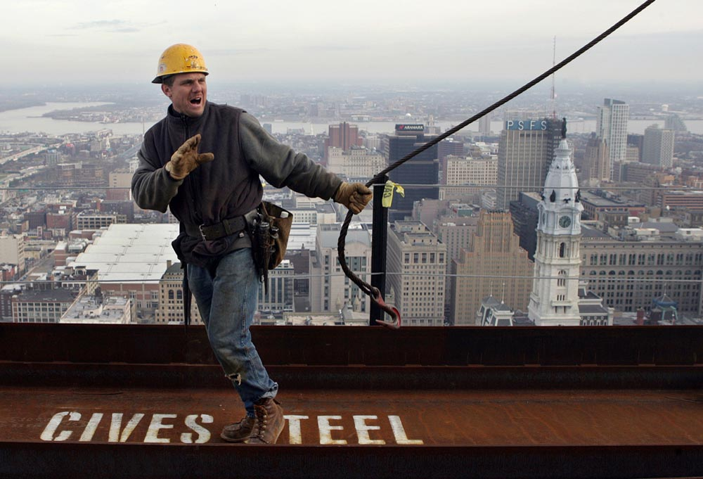 Ironworker prepares to move a beam on the 46th floor of the Comcast Center.