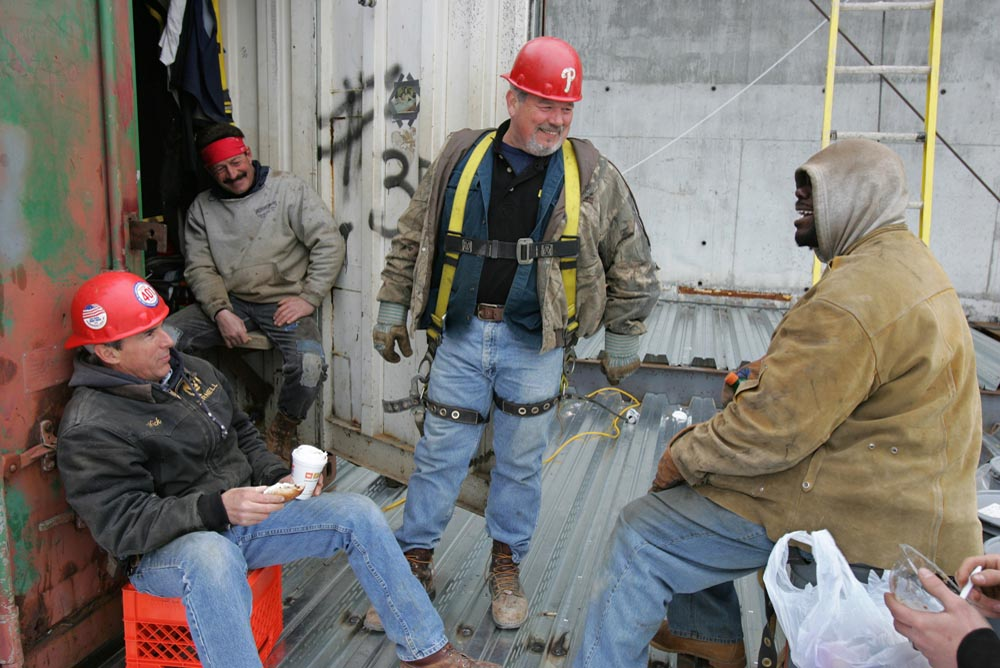 Ironworkers take a morning break.