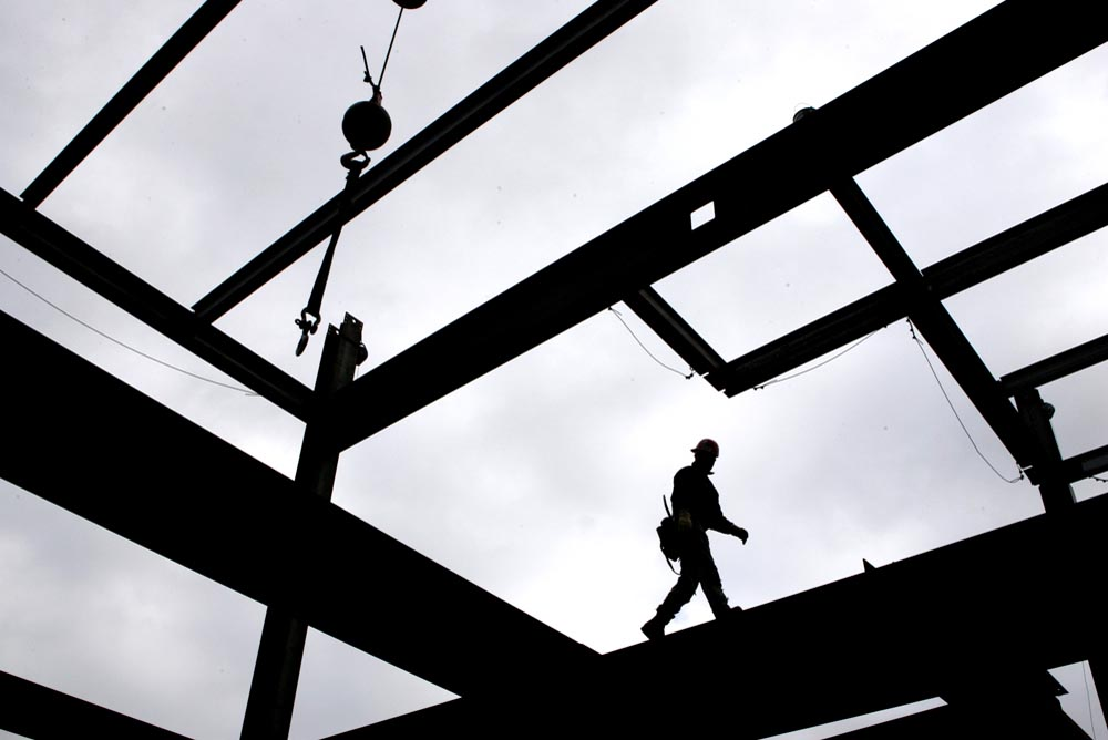 An ironworker walk s on an interior beam on the 47th floor of the Comcast Center.