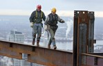 Ironworkers walk on an interior beam on the 47th floor of the Comcast Center.