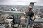 An ironworker guides a steel beam into place on the 55th floor of the Comcast Tower.