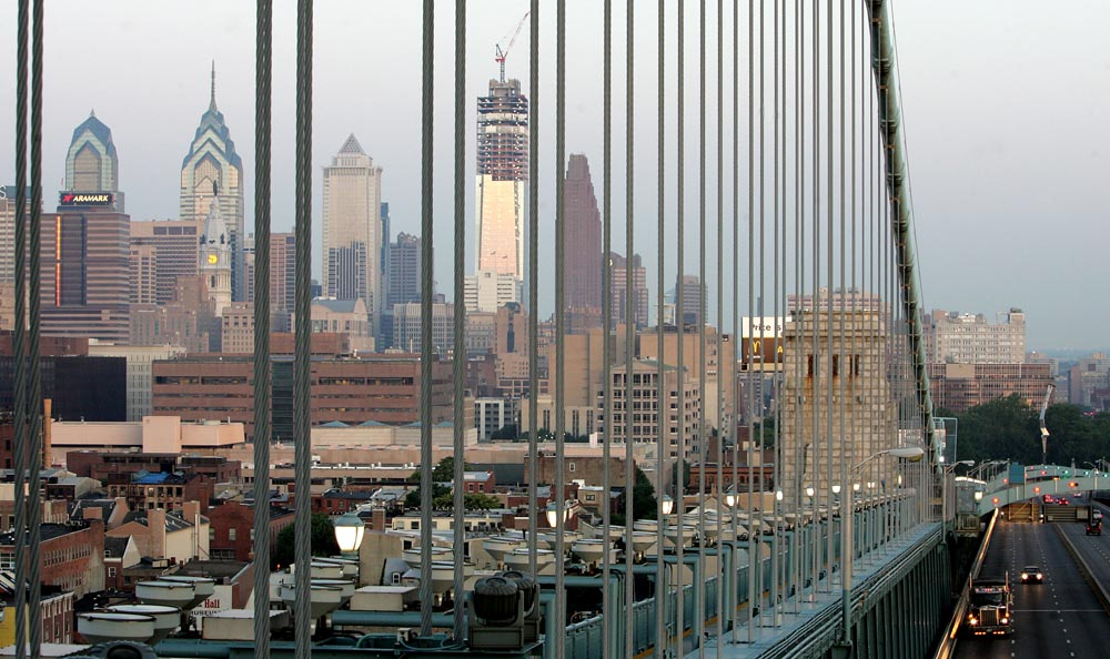 View of Philadelphia's skyline from the Ben Franklin Bridge with the Comcast Center under construction. It took approximately 9,200 pieces of steel to complete the building's structural framework.The largest girder was 90,000 lbs., (45 tons) and the total tonnage was approximately 12,500.
