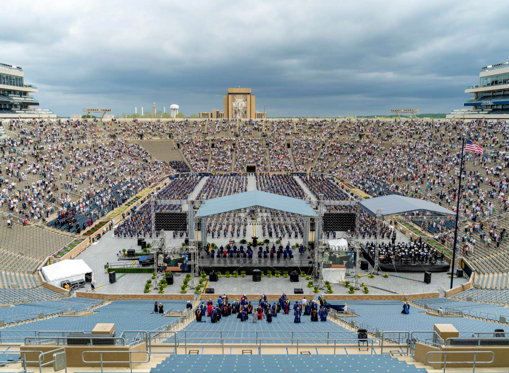 May 23, 2021; Rev. James K. Foster, C.S.C., sings America the Beautiful at the opening of the 176th Commencement Ceremony in Notre Dame Stadium. (Photo by Barbara Johnston/University of Notre Dame)