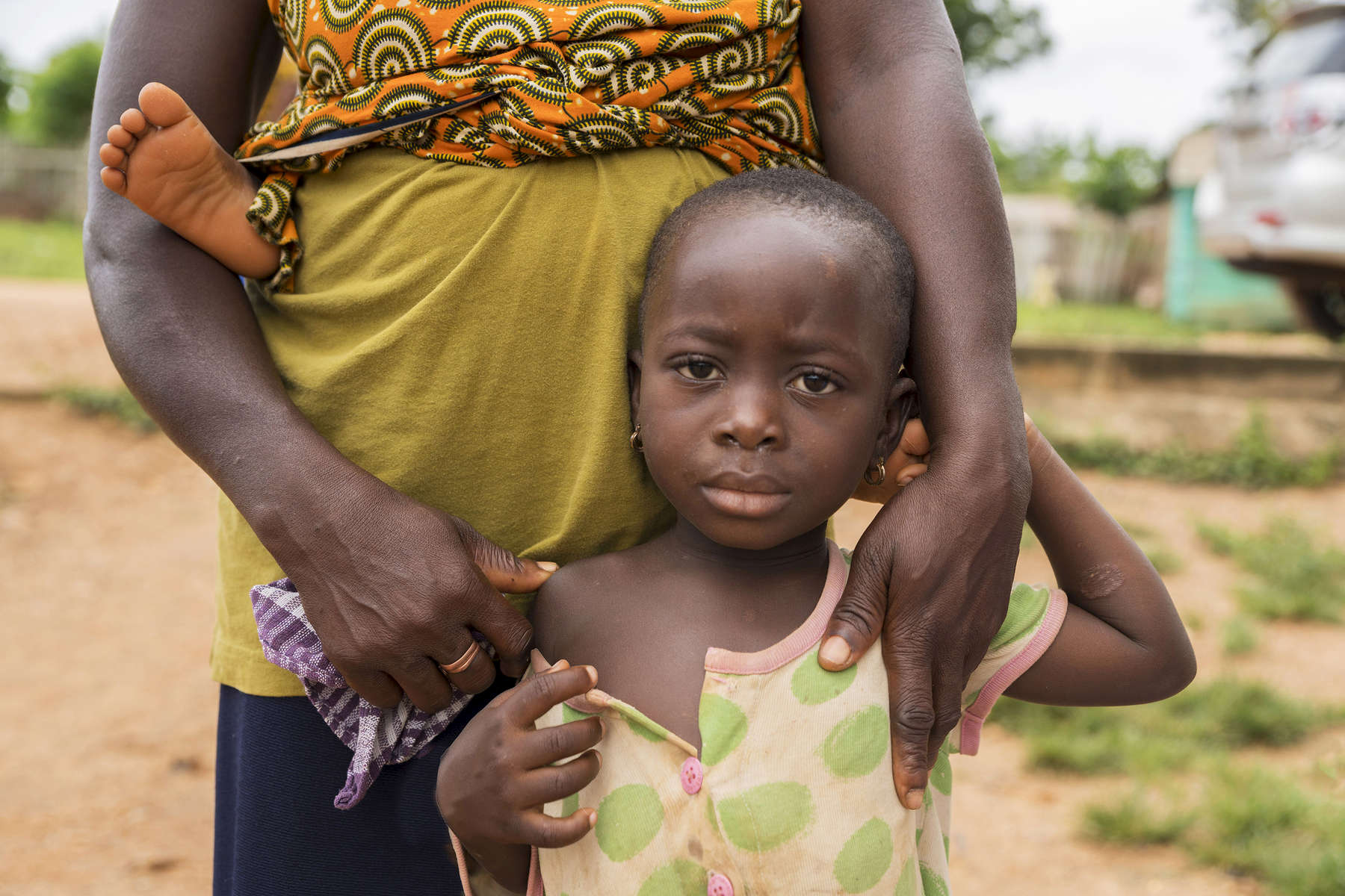 July 6, 2018; A woman with her children in the Central Region of Ghana. (Photo by Barbara Johnston/University of Notre Dame)