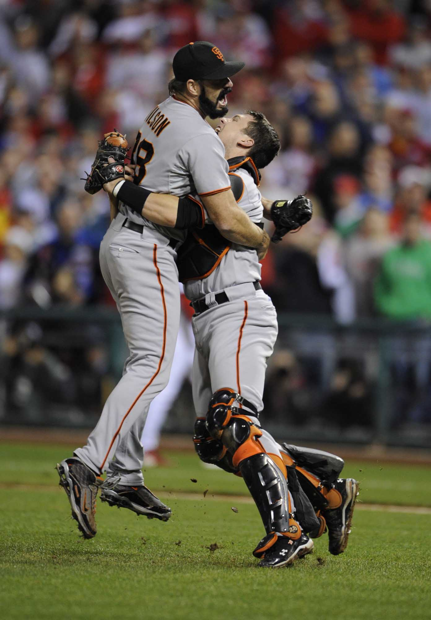 San Francisco Giants pitcher Brian Wilson and catcher Buster Posey celebrate after the Giants won  the National League pennant, 3 to 2, against the Philadelphia Phillies on October 23, 2010 at Citizens Bank Park.