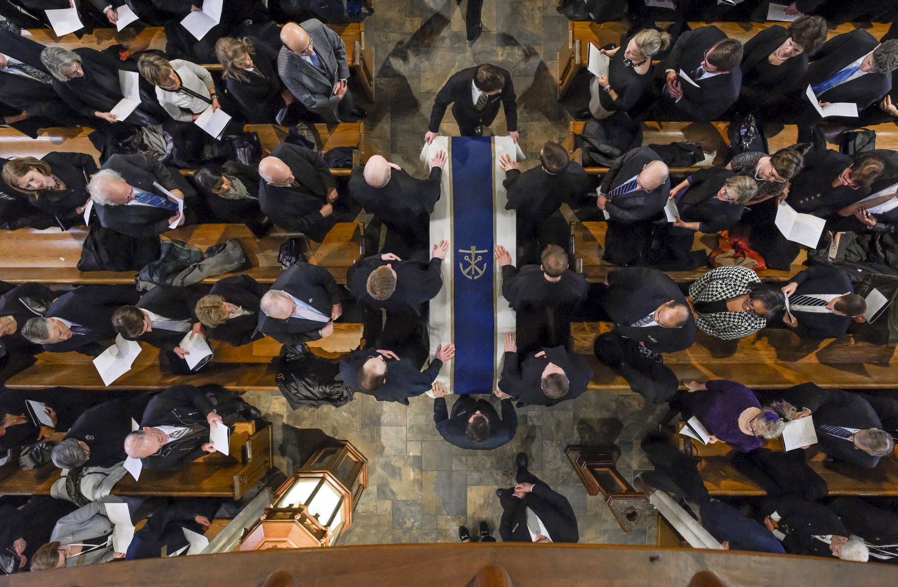 The casket of President Emeritus Rev. Theodore M. Hesburgh, C.S.C. is moved toward the front of the Basilica of the Sacred Heart at the beginning of the funeral Mass.