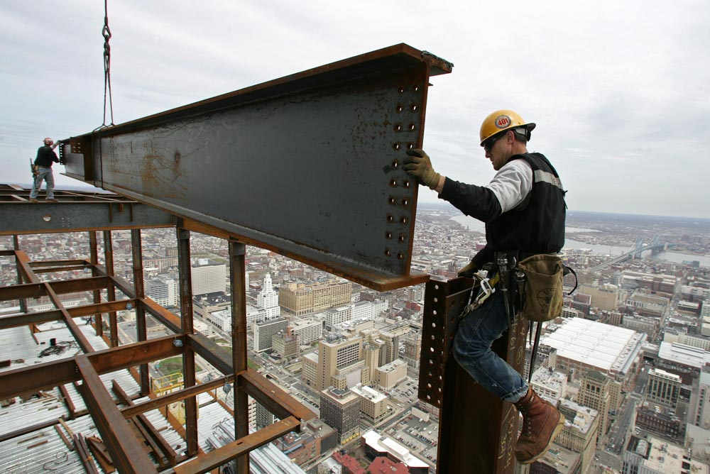 Ironworkers prepare to connect a perimeter beam on the 57th floor of the Comcast Center. Here they are working approximately 876 feet above street level.
