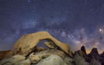 The Milky Way Galaxy Above Arch Rock in Joshua Tree National Park, California.