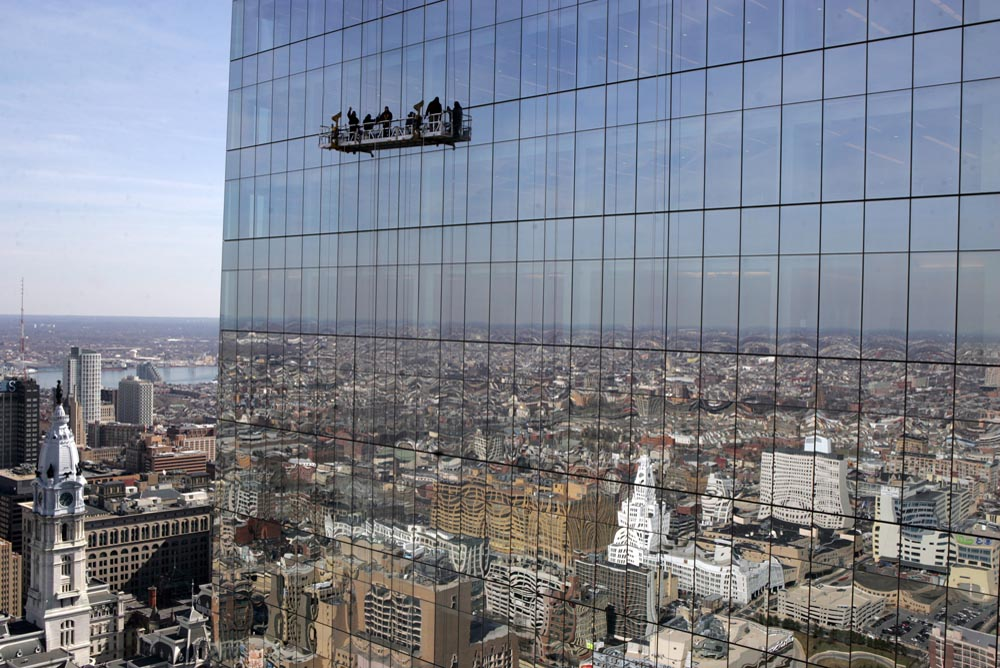 A crew of window washers work on the north wall of the Comcast Center, Philadelphia's tallest building.
